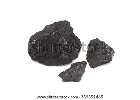 Three pieces of Anthracite coal on white. Coal is one of the most commonly used fossil fuels and is a major component in power generation globally. - stock photo