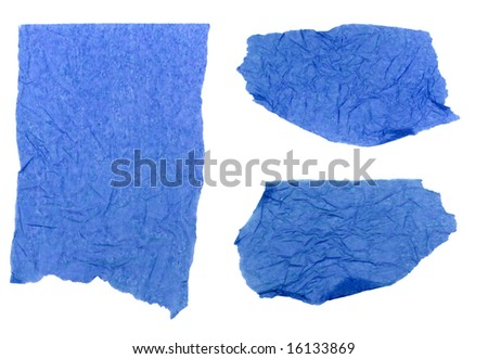 Three pieces of blue tissue paper ripped, wrinkled and torn, isolated on a white background. - stock photo