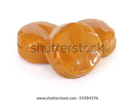 Three Pieces of Caramel Candy Isolated on a White Background - stock photo