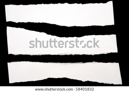 Three pieces of paper on black