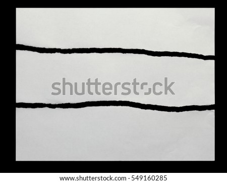 three pieces of torn paper on a black background