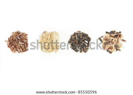 Three piles of different types of rice with mixed rice. - stock photo
