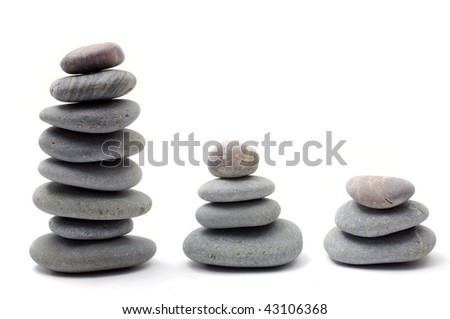 Three piles of stacked pebbles - stock photo
