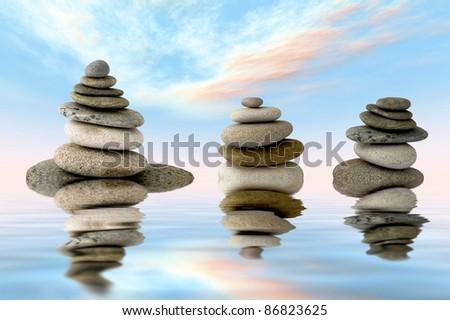 three piles of stones for zen balance - stock photo