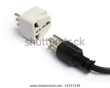 three-pin plug and adapter on white background - stock photo