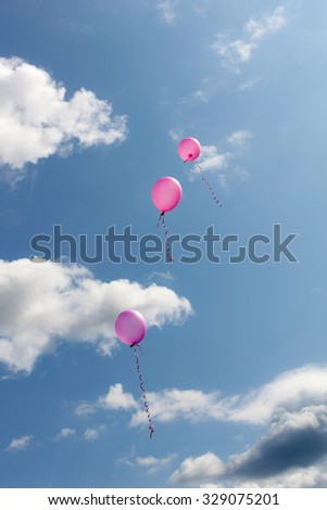 three pink balloons flying in the sky - stock photo