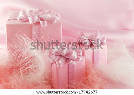 Three pink boxes with gift on the pink background - stock photo