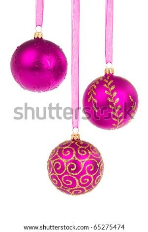 Three pink Christmas baubles hanging isolated on white background - stock photo