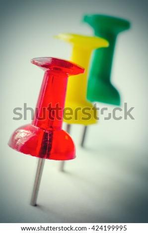 three pins in a board macro - stock photo
