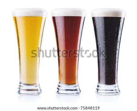 Three pints of beer, of three different colors, isolated on a white background. - stock photo
