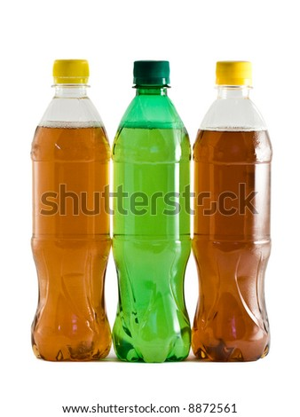 Three plastic bottles with a drink isolated on white - stock photo