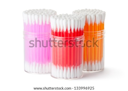 Three plastic box with assorted colors cotton swabs. Isolated on a white. - stock photo