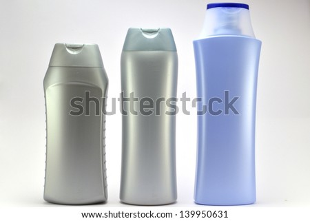 three plastic jars on a white background