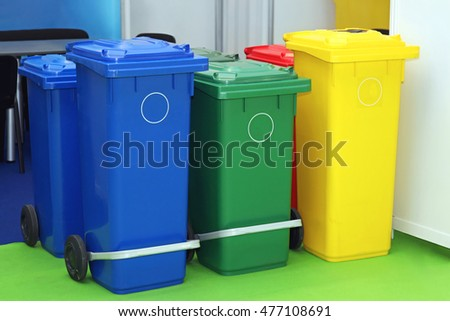 Three Plastic Recycling Bins For Sorting Waste