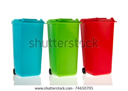 Three plastic rolling containers for garbage in a row