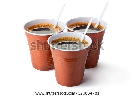 Three plastic vending cups filled with coffee. Isolated on a white. - stock photo
