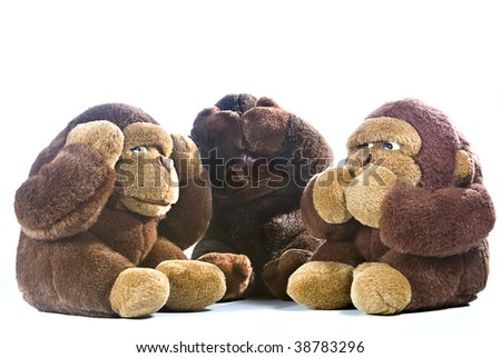 Three plush gorillas representing the proverb of the wise monkeys - stock photo