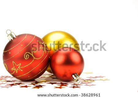 Three polished christmas balls with red glitter stars on the white background