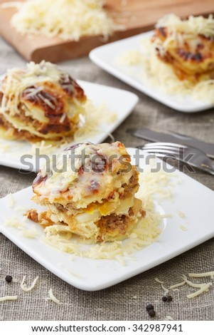 three portions of baked potatoes and meat - stock photo