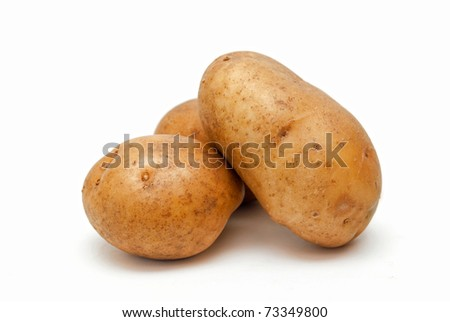 Three potatoes isolate on a white background - stock photo