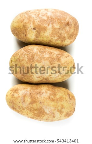Three potatoes isolated on a white background