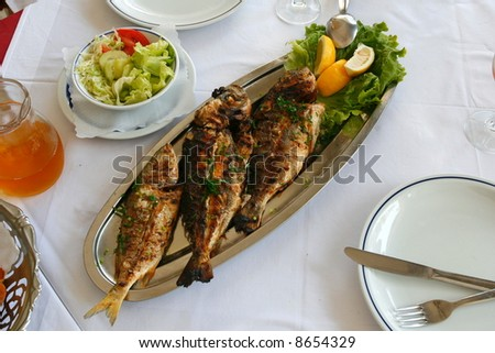 Three prepared sea fish - stock photo