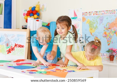 Three preschoolers in the classroom