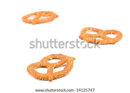 Three pretzels on a white background - stock photo