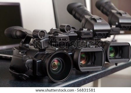 three professional digital video cameras - stock photo