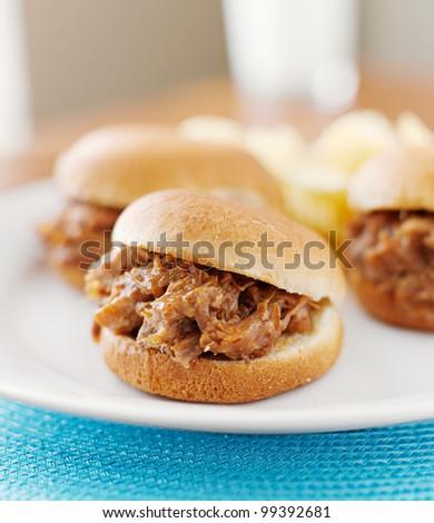 three pulled pork bbq mini sandwich sliders. - stock photo