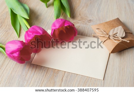 Three purple tulips and space for text - stock photo