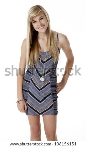 Three quarter front view of pretty blond teenage girl on white. - stock photo