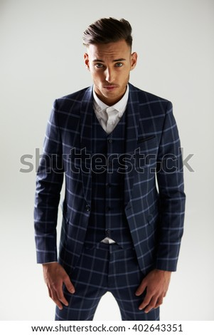 Three quarter length front view of young man wearing suit - stock photo