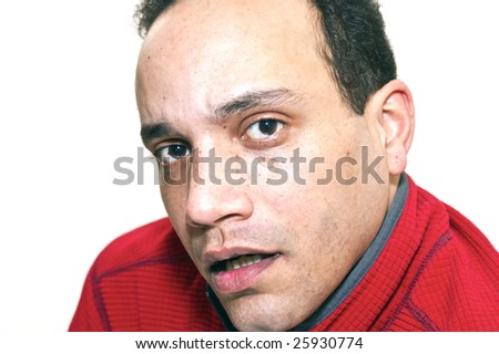 three quarter portrait of african american male wearing red shirt against white background appears to be talking