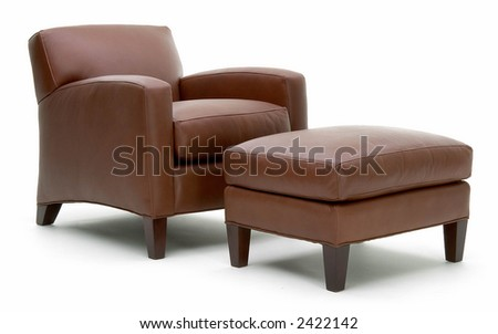 Three quarter view of leather chair and ottoman