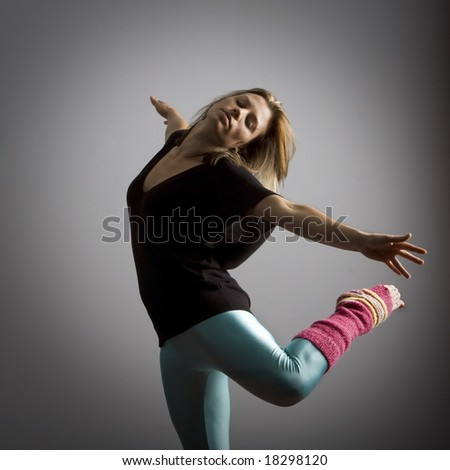 Three quarter view of young female dancer. - stock photo