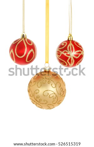 Three red and gold glitter Christmas bauble decorations isolated against white