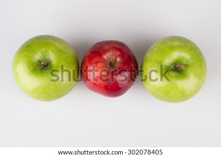 three red and green apples. fresh fruit composition on white - stock photo