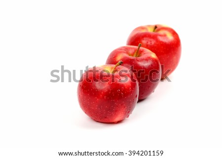 three red apple on white background
