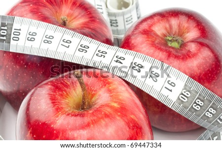 Three red apples with tape - stock photo