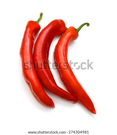 Three red chili peppers isolated on the white - stock photo