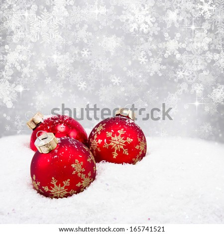 Three red christmas balls on silver background - stock photo