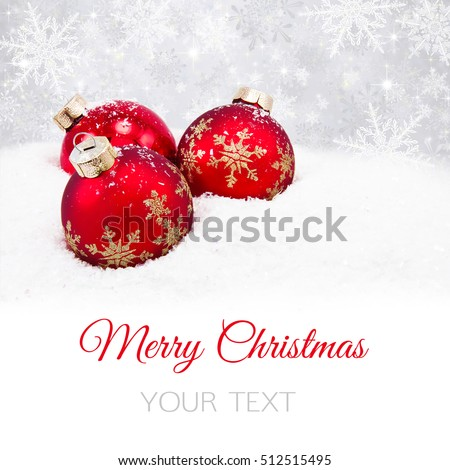 Three red christmas balls on silver background