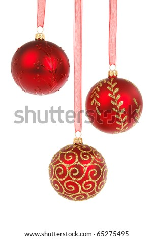 Three red Christmas baubles hanging isolated on white background