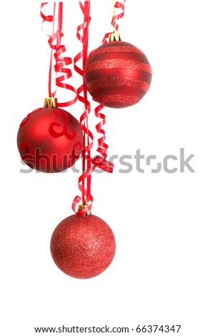 Three red Christmas baubles hanging on a ribbon isolated on white background with copy space. - stock photo