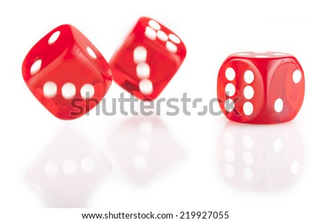 Three red dice isolated on white background with reflection - stock photo