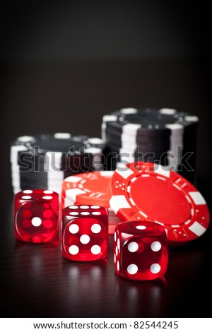 Three red dices and chips