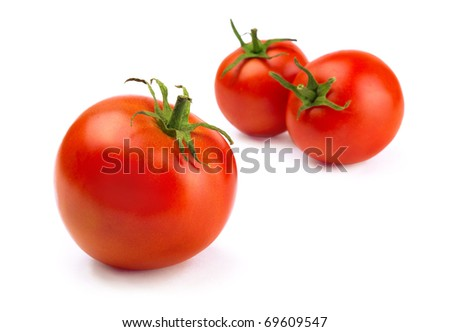 Three red fresh ripened  tomatoes isolated on white - stock photo