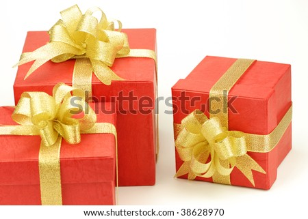 Three red gift box with golden ribbon isolated on the white background