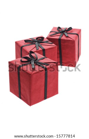 Three red gift boxes with black bows and ribbons